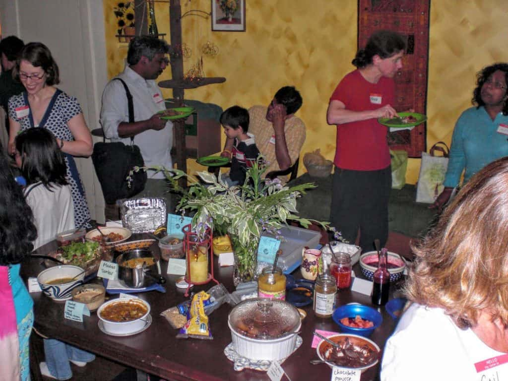 wafflers congregate around vegan waffle toppings