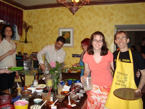 Hosts visit with guests & try some of the amazing toppings. (Photo by Lucy D.)