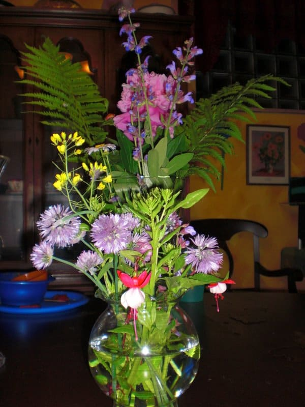 Centerpieces created by neighbor kids, using flowers from our yards.