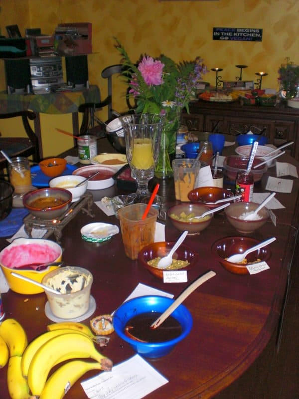 table full of assorted vegan waffle toppings