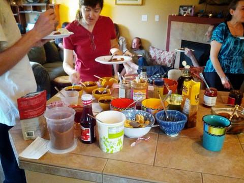 waffle party guests piling on toppings