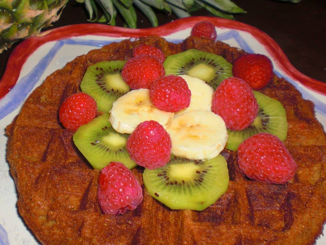 vegan waffles with bananas, kiwi, and raspberries