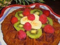 vegan waffles with bananas, kiwi, and raspberries