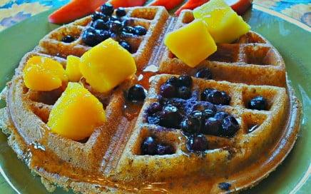 naked gluten-free vegan waffle with blueberries, mango, maple syrup