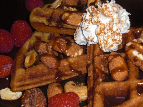 sweet yeast-raised vegan waffle, decadent with fruit and nuts