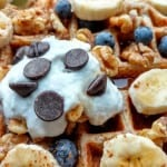 vegan sourdough waffles, with coconut cream, chocolate chips, and walnuts, closeup