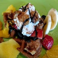 vegan waffle with banana, fruit, & chocolate closeup