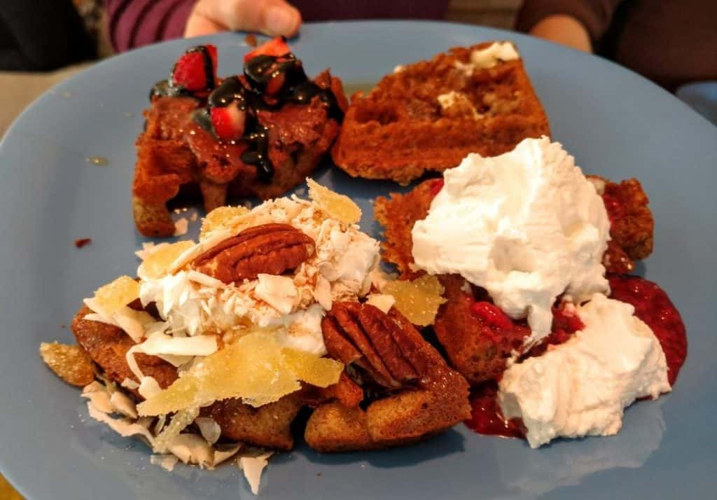 vegan waffles with coconut cream, pecans, & fruit