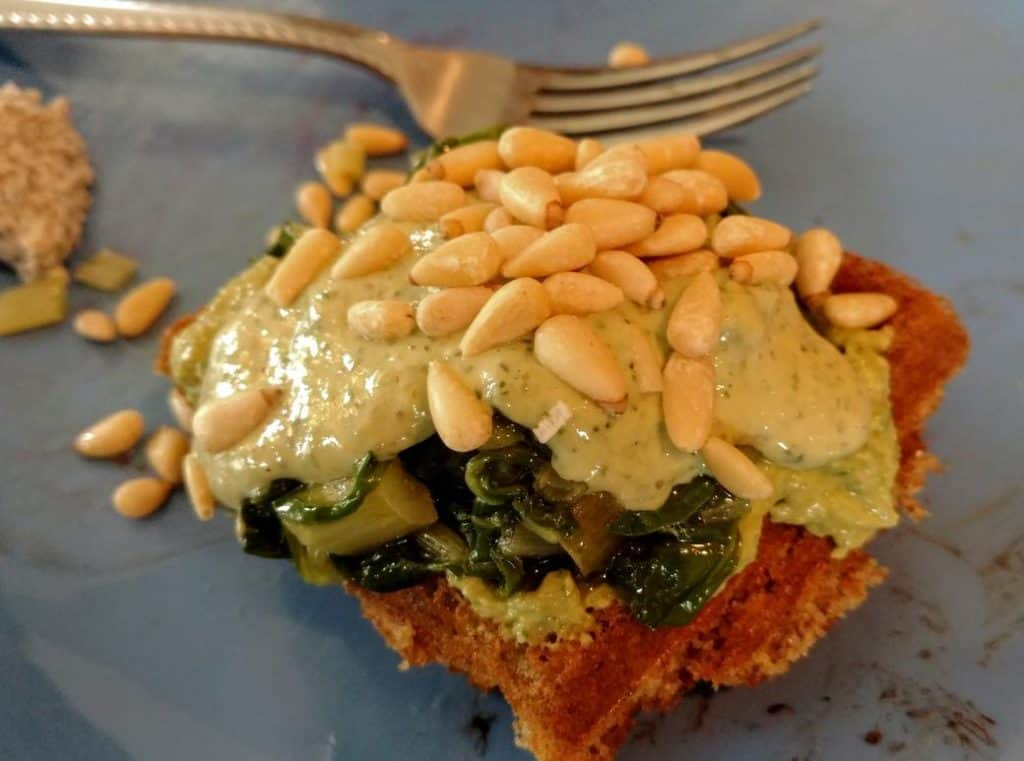 savory vegan waffle with tahini, pine nuts, & chard