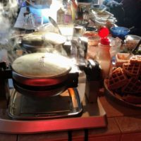 steaming waffle makers at a waffle party
