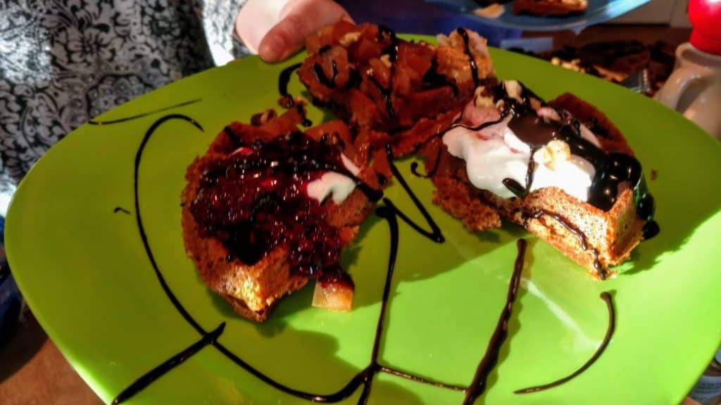 vegan waffles with chocolate syrup and ice cream