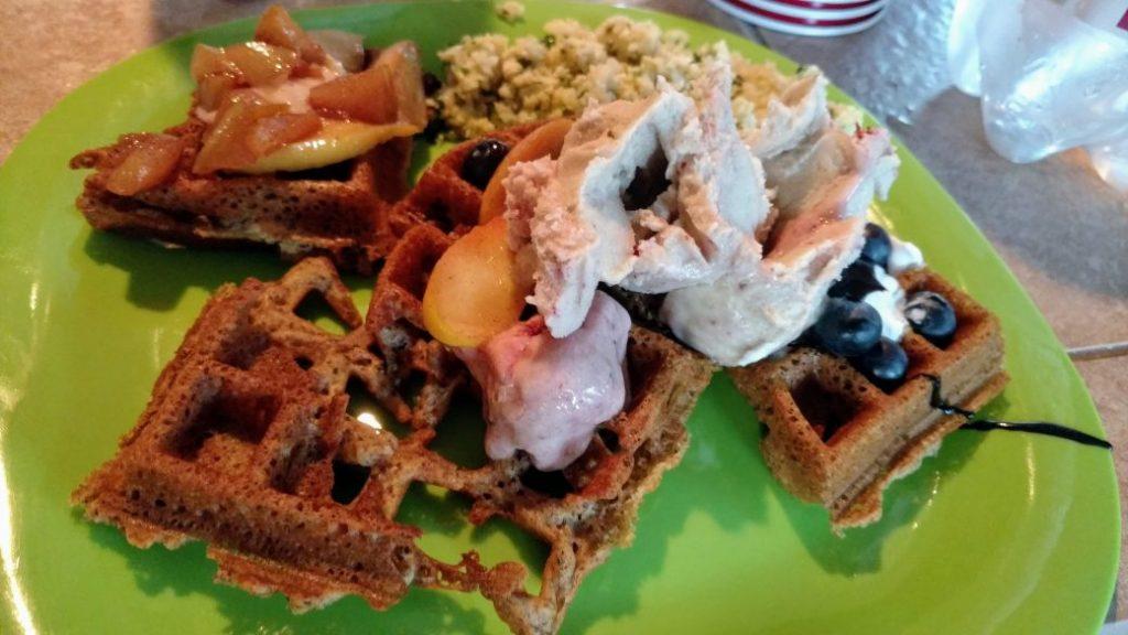 vegan waffles with ice cream, blueberries, apples