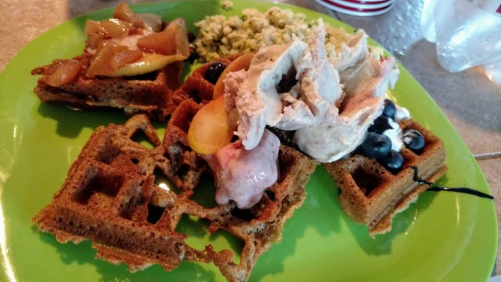 vegan waffles with ice cream, blueberries, apples