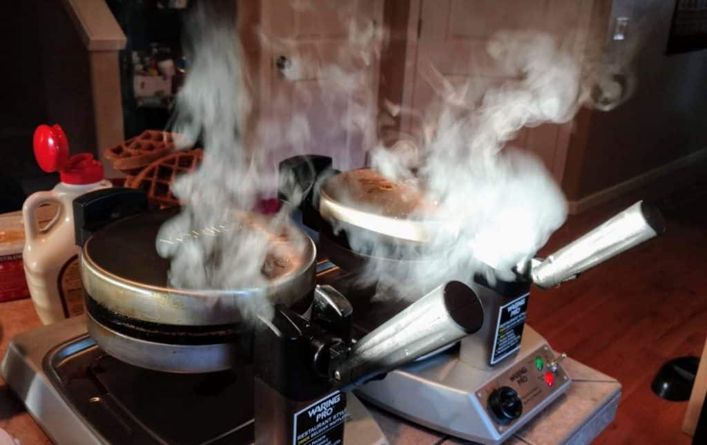 waffle makers steaming during party