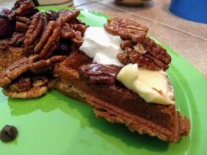 vegan waffles with caramelized pecans, coconut cream