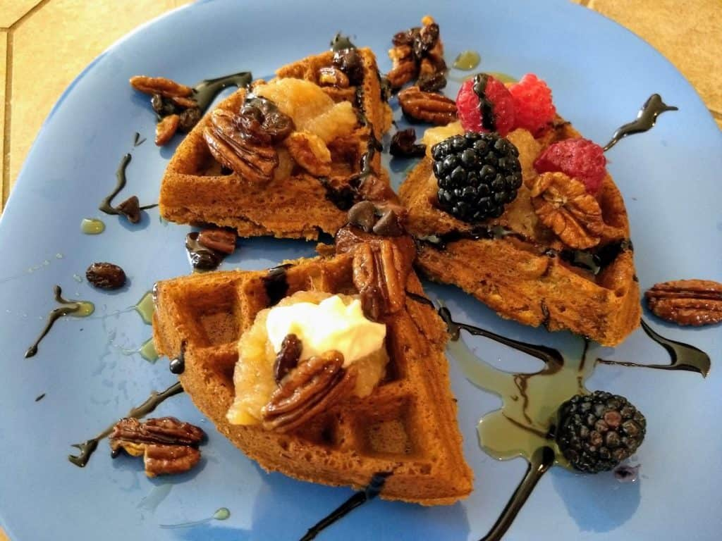 vegan waffles with toppings and chocolate drizzle